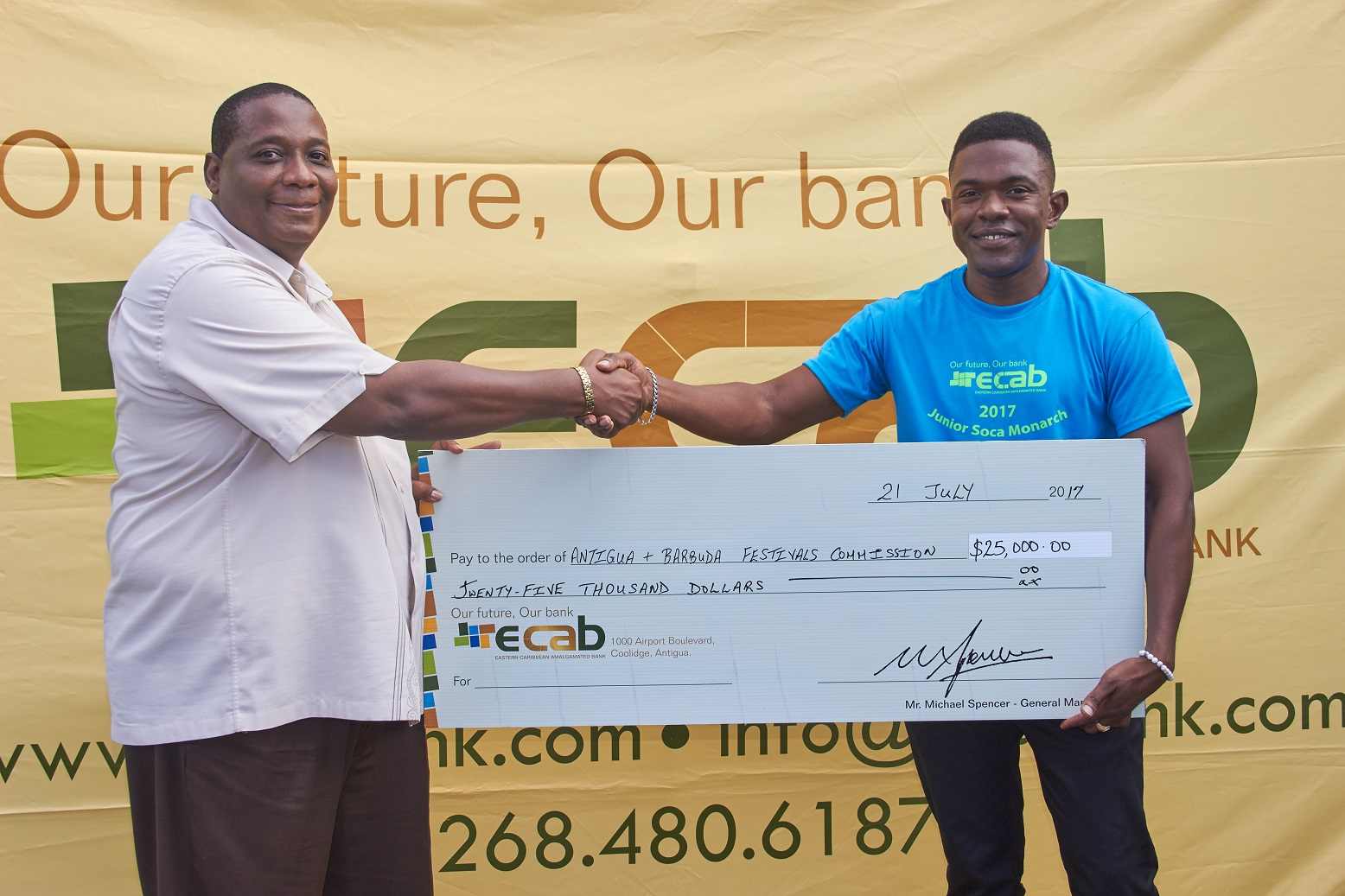 Ag PS Clarence Pilgrim accepts cheque from ECAB Marketing Rep Stosh Browne 2